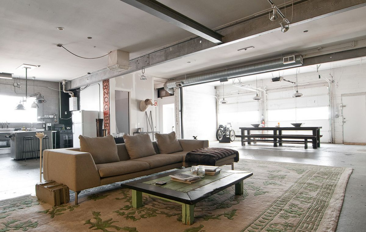 Exposed ductwork and pipes complement the concrete elements of this loft.