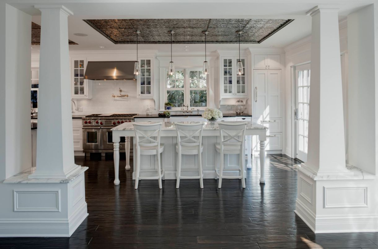 A tin ceiling can be used in a tray to accent a space like this kitchen island.